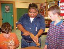 Carving culture: A Sliammon elder shows how to carve traditional paddles.