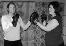 GLOVES ON: Connie Kucharski and Louisa Ring spar at the Powell River Boxing Club Powell River Pugilism