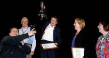 Speaking champion: Claude Poumerol cheering at having won the District 21 Toastmasters International Speech Competition in Whistler, BC.