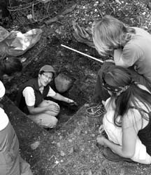 IN THE HOLE: Dana Lepofsky goes over the findings of an excavation site with her archaeology team. Photo by Emma Levez Larocque.