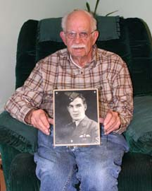 AT PEACE: Powell River Veteran Hayden Hughes holds a photograph of his brother the late Gordon Booth Hughes who was killed while training during World War II.