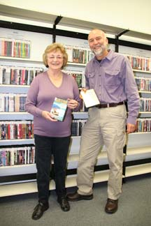 BUFFED MOVIES: Librarian Charlie Kregel and Friends of the Library volunteer Charlotte Shulz show off the new DVD collection at the Powell River Library.